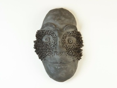 Pit-fired mask